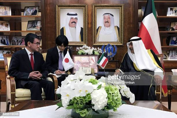 Japanese Foreign Minister Taro Kono and Kuwait Foreign Minister Sabah AlKhalid AlSabah talk during their meeting at the Foreign Ministry on September...