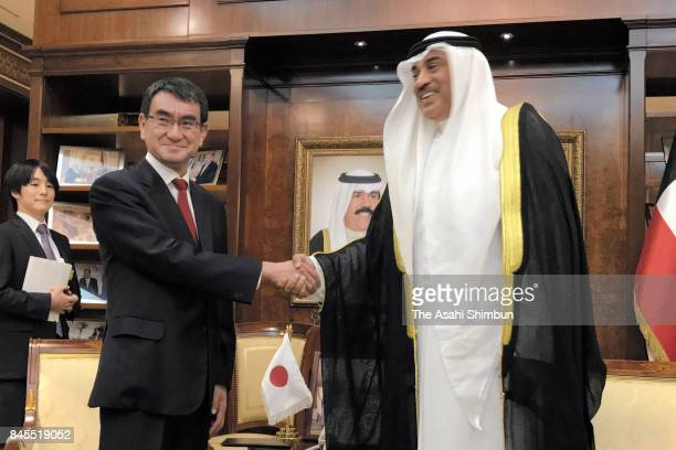 Japanese Foreign Minister Taro Kono and Kuwait Foreign Minister Sabah AlKhalid AlSabah shake hands prior to their meeting at the Foreign Ministry on...