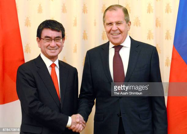 Japanese Foreign Minister Taro Kono and Russian Foreign Minister Sergei Lavrov shake hands prior to their meeting at the Reception House of the...