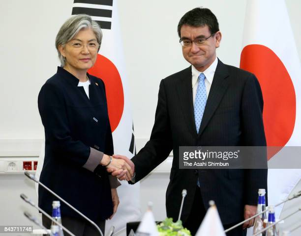 Japanese Foreign Minister Taro Kono and South Korean Foreign Minister Kang Kyungwha shake hands prior to their meeting on September 7 2017 in...