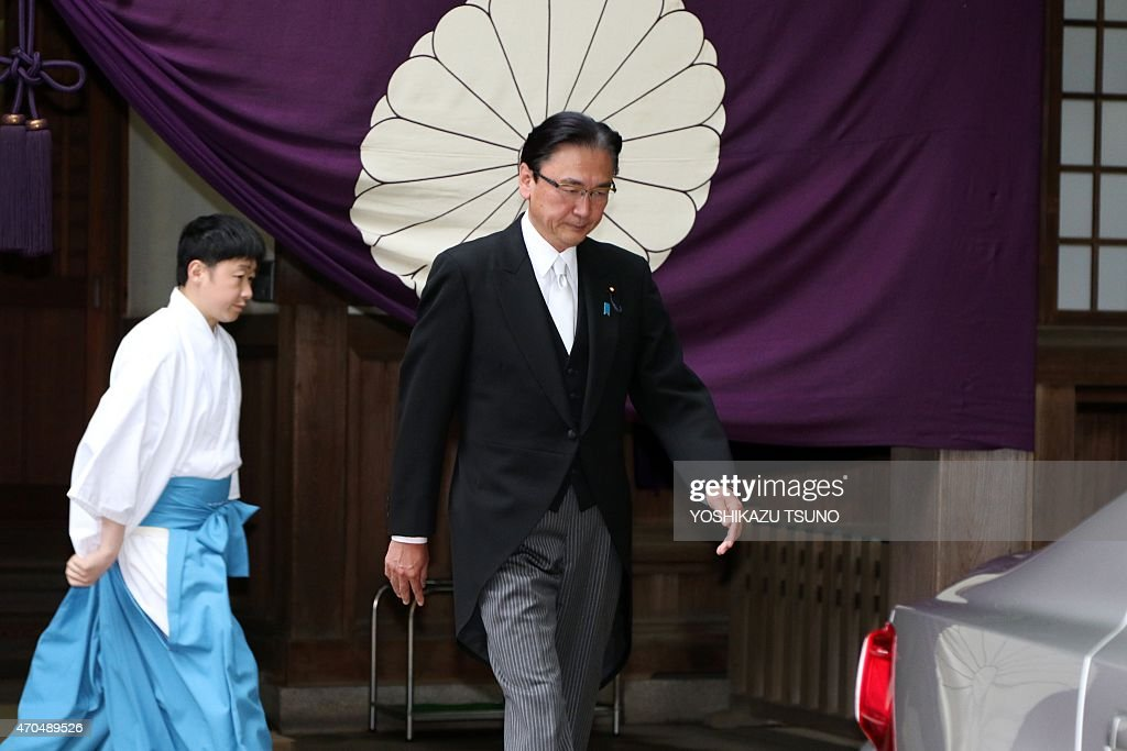 Japanese former state minister <a gi-track='captionPersonalityLinkClicked' href=/galleries/search?phrase=Keiji+Furuya&family=editorial&specificpeople=10094135 ng-click='$event.stopPropagation()'>Keiji Furuya</a> (C) leaves the controversial Yasukuni war shrine in Tokyo on April 21, 2015, to offer prayers for people who died during World War II for the spring festival of the shrine. Abe made a symbolic donation to the Yasukuni war shrine, but stopped short of visiting in person -- a move that would have infuriated neighbouring countries. Abe donated a sacred 'masakaki' tree to coincide with the start of the three-day spring festival at the shrine in central Tokyo. AFP PHOTO / Yoshikazu TSUNO