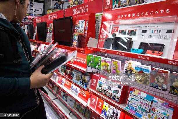 Japanese gamers come to buy the new video game Nintendo Switch games console by Nintendo Co during the first day of sales worldwide in Tokyo Japan on...