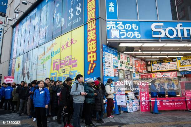 Japanese gamers lineup to buy the new video game Nintendo Switch games console by Nintendo Co during the first day of sales worldwide in Tokyo Japan...