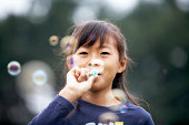 Japanese girl blowing bubbles