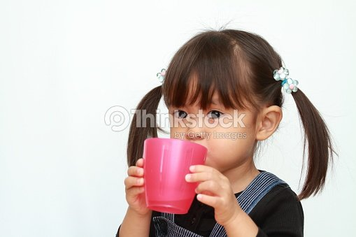 Japanese Girl Drinking Water Stock Photo   Thinkstock