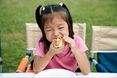 Japanese girl eating a hot dog