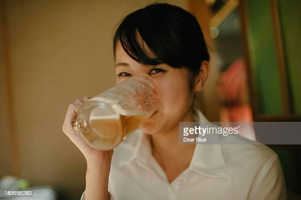 Japanese girl enjoying a beer