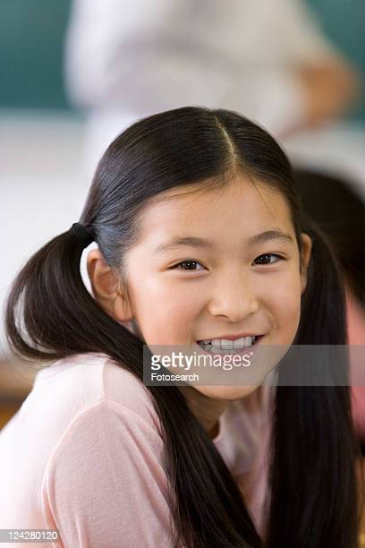 A Japanese Girl Looking At Camera