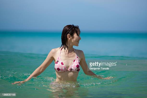 Japanese girl playing in waves