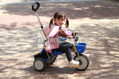 ac48d6b1474 Japanese Girl Riding On The Tricycle Stock Photo   Thinkstock