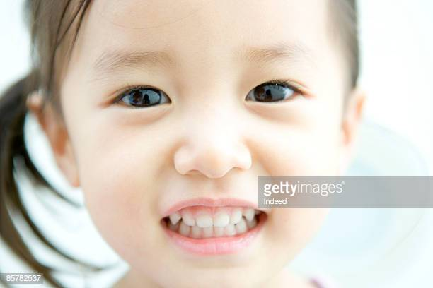 Japanese girl smiling, close up