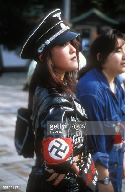 japanese-girl-wearing-a-nazi-outfit-with-swastika-armband-japan-picture-id558221471?s=612x612