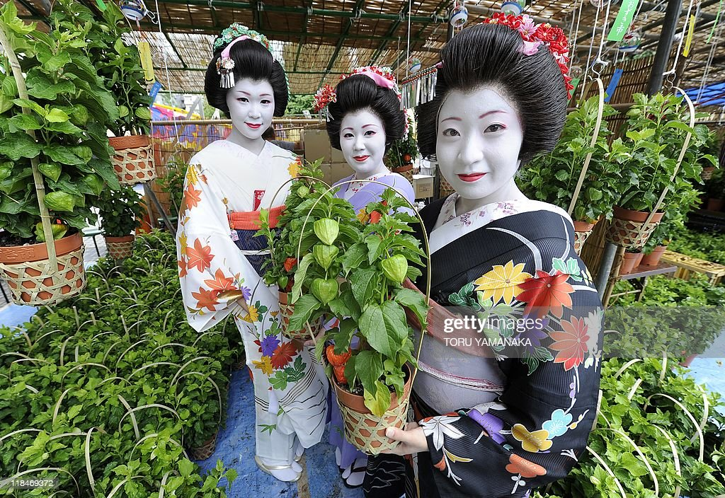 Japanese girls clad in kimonos show off pots of hozuki, Chinese lantern plants, at Sensoji temple in Tokyo on July 8, 2011, at the preview of the annual two-day Chinese lantern plant fair held July 9-10. The plants are considered part of early summer's poetic scenery in Japan and some 500,000 people are expected to visit the fair.