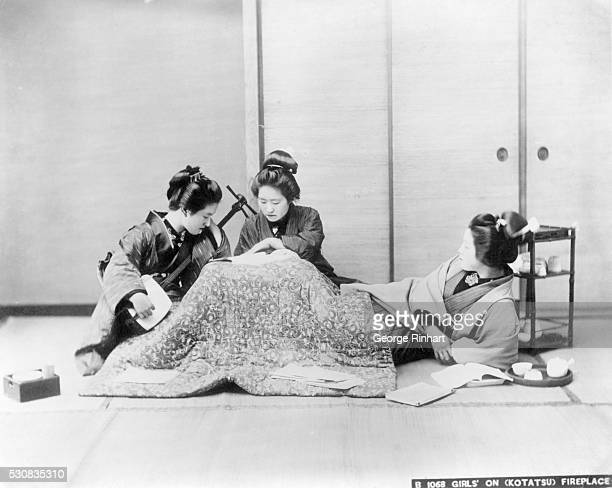 Japanese girls on 'Kotatsu' fireplace