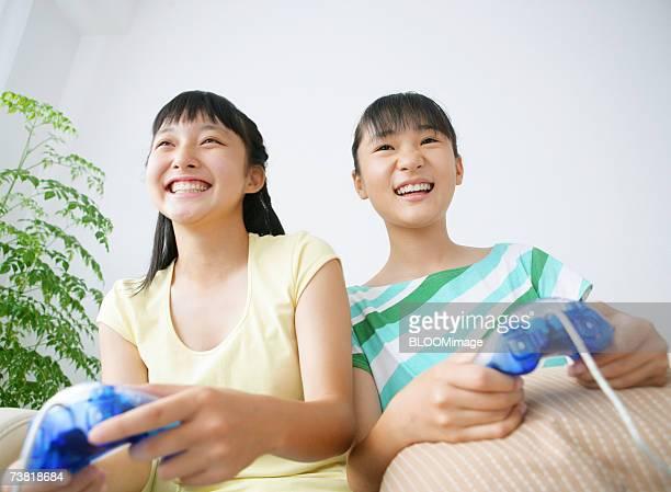 Japanese girls playing TV game