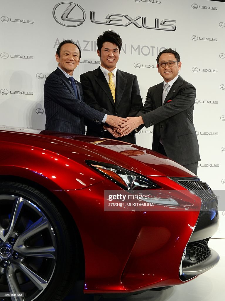 Japanese golfer Hideki Matsuyama (C), Lexus International president Kiyotaka Ise (L) and Lexus Chief Branding Officer (CBO) and Toyota Motor Cooperation president and CEO Akio Toyoda (R) pose beside a Lexus sports coupe, RC during a press conference on Matsuyama's sponsorship with Lexus in Tokyo on December 24, 2013. 21-year-old Matsuyama, the first rookie golfer to top the winnings list on the Japan Golf Tour, signed a three-year sponsorship with Lexus.