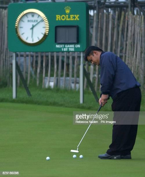 Japanese golfer Kiyoshi Miyazato practises his putting before the first round of the 131st Open Championship Muirfield Scotland