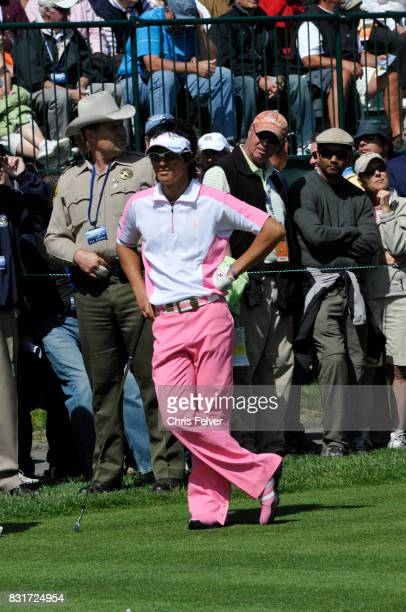 Japanese golfer Ryo Ishikawa leans on his club as he stands on the green during the 110th US Open golf championship Pebble Beach California June 17...