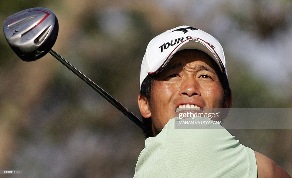 Japanese golfer Taichiro Kiyoto tees off on the eighteenth hole during the final round of the Johnnie Walker Classic 2008 in Gurgaon on the outskirts...