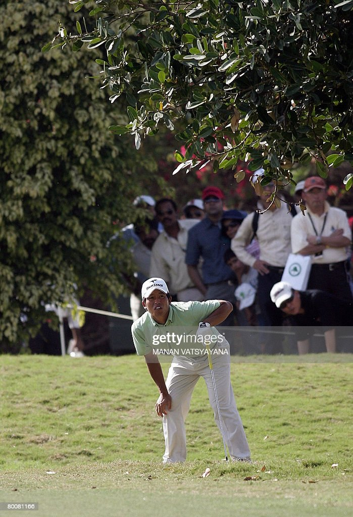 Japanese golfer Taichiro Kiyoto watches his drive on the twelfth green during the final round of the Johnnie Walker Classic 2008 in Gurgaon on the...