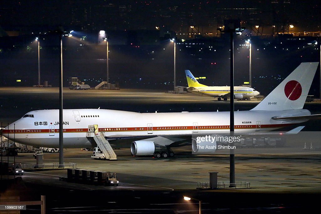 A Japanese government aircraft sits at Tokyo International Airport on January 22, 2013 in Tokyo, Japan. The government aircraft will bring home seven Japanese survivors and bodies of seven victims, three Japanese remain unaccounted for.