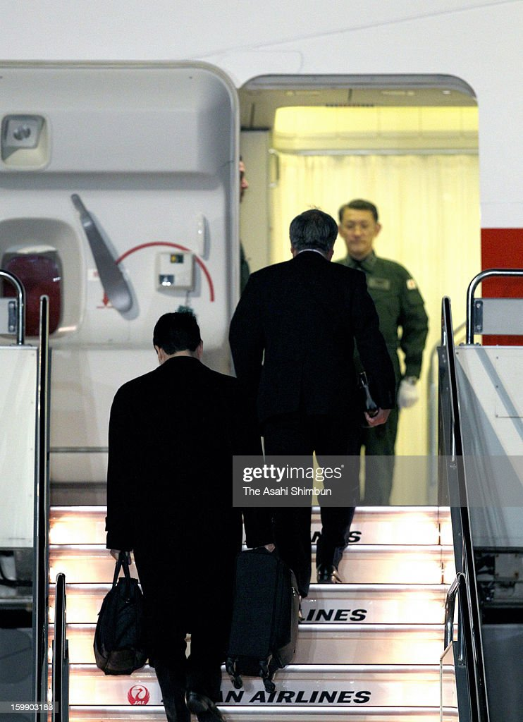 Japanese government staffs and plant constructor JGC Co staffs board to a government airplane at Tokyo International Airport on January 22, 2013 in Tokyo, Japan. The government aircraft will bring home seven Japanese survivors and bodies of seven victims, three Japanese remain unaccounted for.