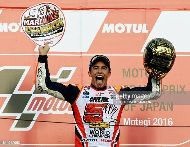 Japanese Grand Prix winner Repsol Honda Team's Spanish rider Marc Marquez celebrates his fifth world champion title on the podium after the MotoGP...