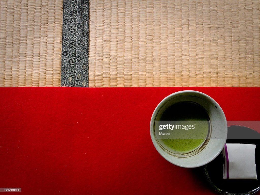 Japanese green tea on red carpet