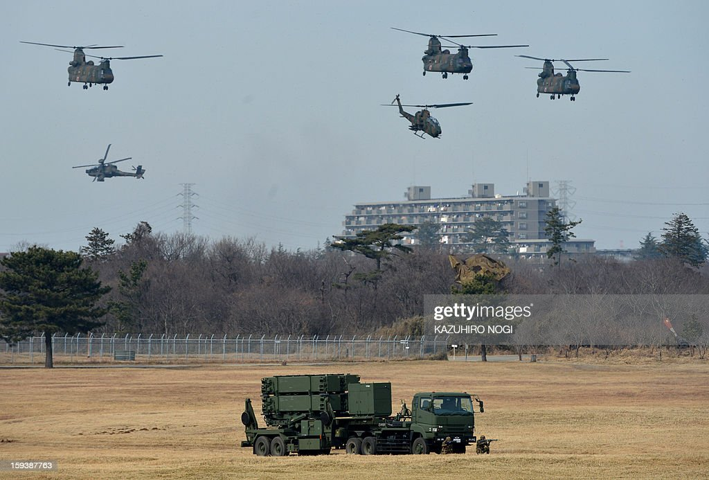 A Japanese Ground Self Defense Force Patriot missile launcher (bottom), a PAC-3 surface-to-air missile defence system, is pictured during a new year drill at the training grounds in Narashino, suburban Tokyo on January 13, 2013. A total of 300 personnel, 20 aircraft and 33 vehicles took part in the open exercise at the defense force's Narashino training ground.