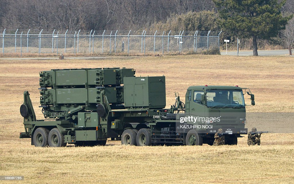 A Japanese Ground Self Defense Force Patriot missile launcher (bottom), a PAC-3 surface-to-air missile defence system, is pictured during a new year drill at the training grounds in Narashino, suburban Tokyo on January 13, 2013. A total of 300 personnel, 20 aircraft and 33 vehicles took part in the open exercise at the defense force's Narashino training ground. AFP PHOTO / KAZUHIRO NOGI
