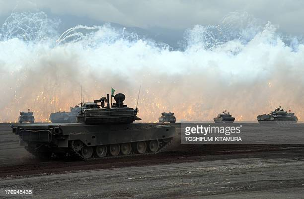 Japanese Ground SelfDefense Forces tanks move during an annual live fire exercise at the HigashiFuji firing range in Gotemba at the foot of Mt Fuji...