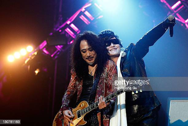 Japanese guitarist Pata and singer Toshi of the band X Japan performs live during a concert at Olympic Gymnasium on October 28 2011 in Seoul South...