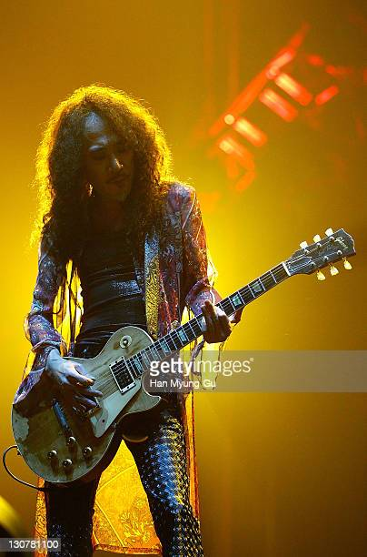 Japanese Guitarist Pata of the band X Japan performs live during a concert at Olympic Gymnasium on October 28 2011 in Seoul South Korea