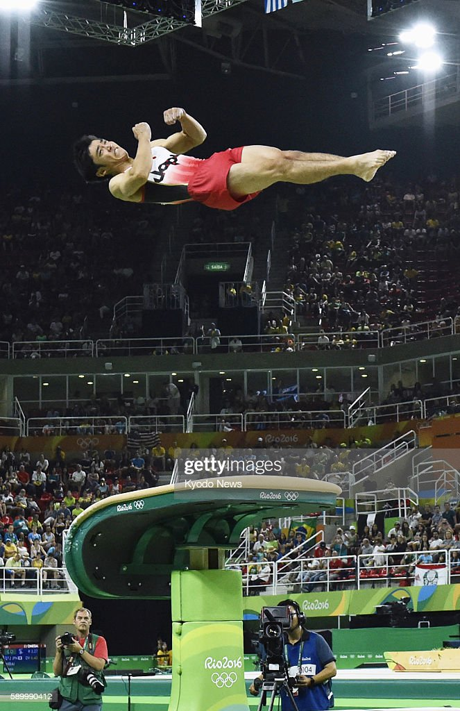 Japanese gymnast Kenzo Shirai performs in the men's vault final with a new technique a threeandahalf twisting layout Yurchenko at the Rio de Janeiro...