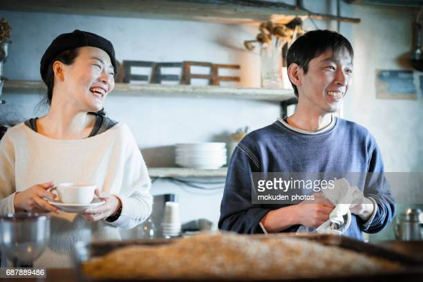 Japanese happy couple living in a free lifestyle at cafe owners