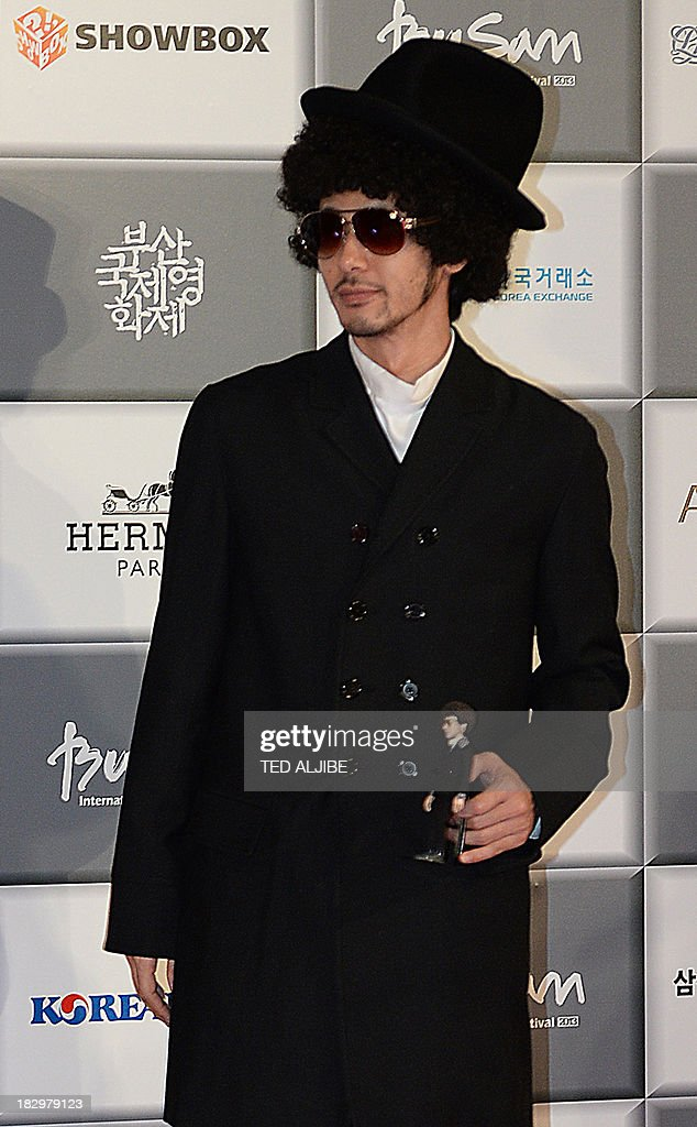 Japanese hearthrob Joe Odagiri arrives for the opening ceremony of the 18th Busan International Film Festival (BIFF) in Busan on October 3, 2013. Stars of Asian cinema gathered in the South Korean port city of Busan October 3, for the opening of the region's biggest film festival, showcasing new talent in a region where box office takings will soon outstrip North America.