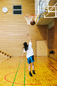 Japanese high school. A school gymnasium. Shooting a hoop