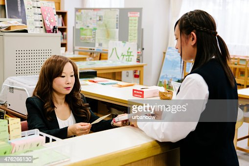 Japanese high school, borrowing a book, female student and librarian