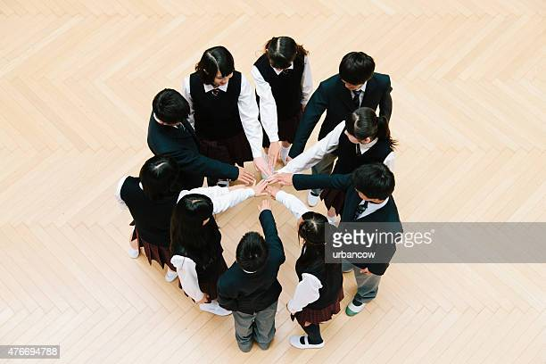 Japanese high school children, ten teenage children, circle of hands