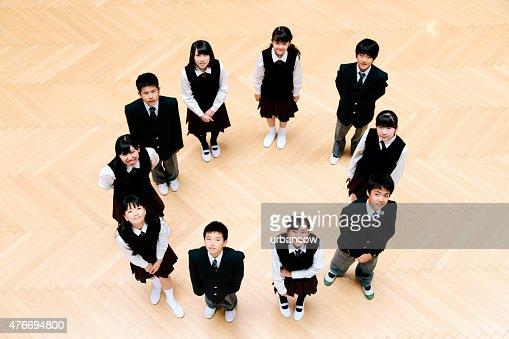 Japanese high school children, ten teenage children in school hall