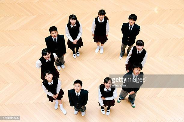 Japanese high school children, ten teenage children in school hall