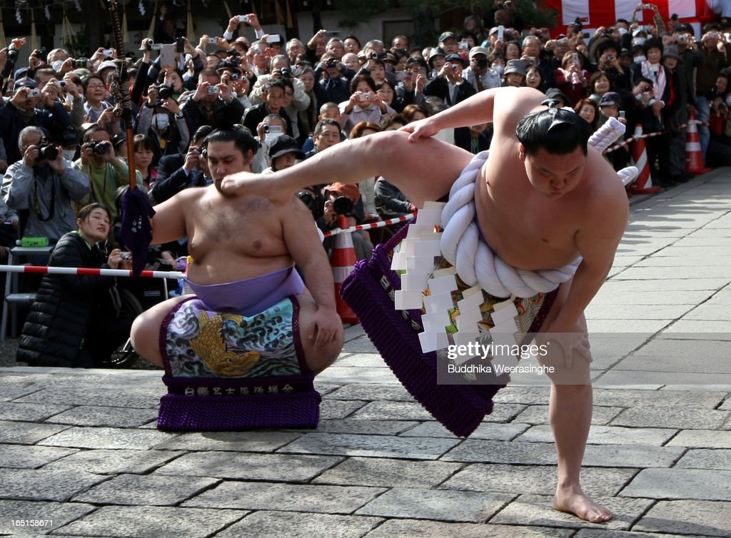 Japanese highest rank sumo wrestler <a gi-track='captionPersonalityLinkClicked' href=/galleries/search?phrase=Hakuho&family=editorial&specificpeople=625611 ng-click='$event.stopPropagation()'>Hakuho</a> Sho (R) performs ritual to entertain the gods during the Mitsuyama Taisai Festival of Itate Hyozu Shrine at Shirahama on April 1, 2013 in Himeji, Japan. The festival is held once in 20 years since 1593. Priests of Itate Hyozu Shrine welcome all the gods across the country to pray for peace and prosperity.