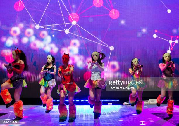 Japanese idol group Kamenjoshi perform in front of an imax Light 6W seethrough LED display inside the Elltech Co booth during the 4th Live...