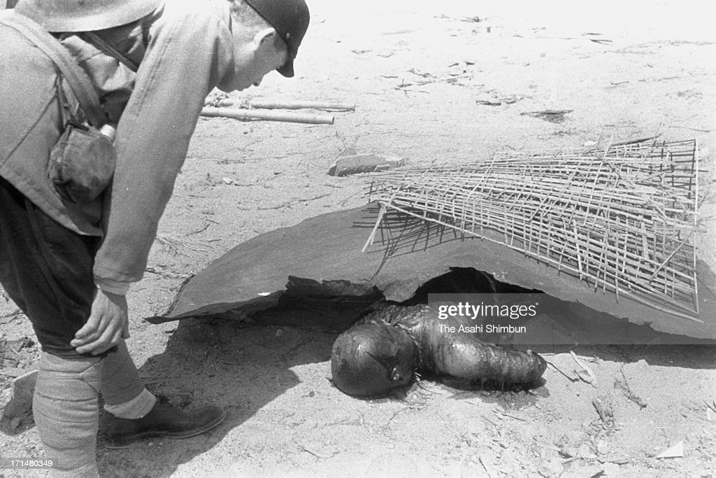 A Japanese Imperial Army investigation team member checks a body of the Hiroshima atomic bomb victim, taken photographed between August 10 to 12, 1945 in Hiroshima, Japan. The world's first atomic bomb was dropped on Hiroshima on August 6, 1945 by the United States at the end of World War II, killing an estimated 70,000 people instantly. Three days later another atomic bomb was dropped on Nagasaki. With the effects of radiation, many thousands more dying over the following years and the number of the victims are thought to be approximately 340,000 people.