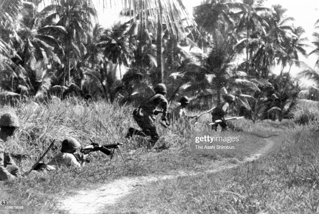 Japanese Imperial Army soldiers march toward Singapore on January 2 1942 in Malaysia