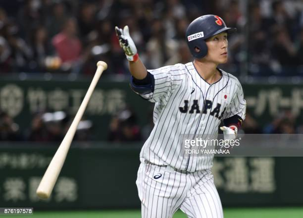 Japanese infielder Ryoma Nishikawa looks at the ball when he hits a solo homer at the seventh inning during the Asia Professional Baseball...