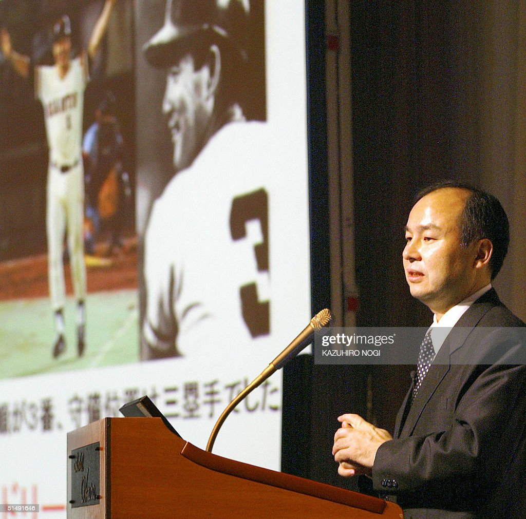 Japanese Internet provider Softbank Corp President Masayoshi Son takes a presentation with a picture of Japanese baseball legend Sadaharu Oh Shigeo...