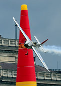 Japanese Josihide Muroja of the Team Falken with his Edge 540 V3 plane competes during the Red Bull Air Race World Championship over the river Danube...