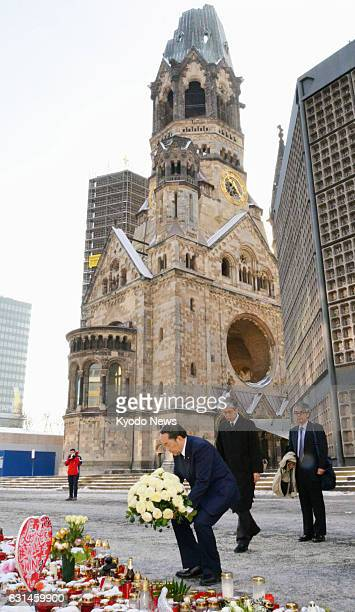 Japanese Justice Minister Katsutoshi Kaneda lays flowers in Berlin on Jan 10 2017 at the site of the truck attack on a Christmas market in December...