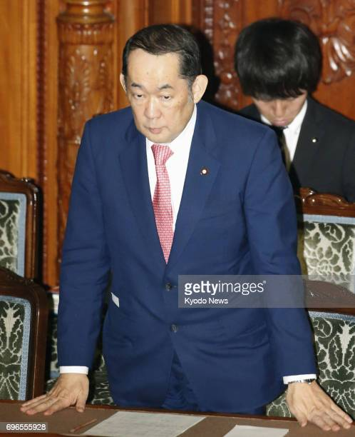 Japanese Justice Minister Katsutoshi Kaneda stands in appreciation at a House of Councillors plenary session in Tokyo on June 16 as parliament...